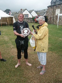 Leigh Gething of Bude Canoe Club being presented with BCHS Shield by  Audrey Wheatley