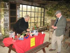 Bryan Dudley Stamp manning the raffle stall, with member Michael Westall, at the barge workshop
