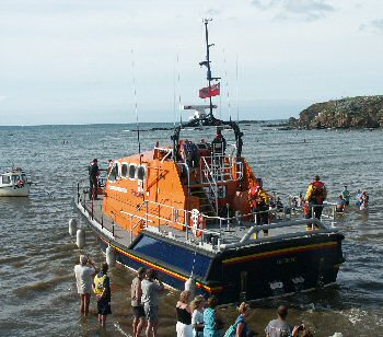 Visiting lifeboat leaving the sea lock
